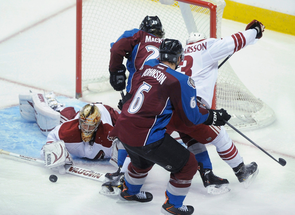 . Phoenix goalie Thomas Greiss (1) made a sprawling save under pressure in the second period.  Photo By Karl Gehring/The Denver Post