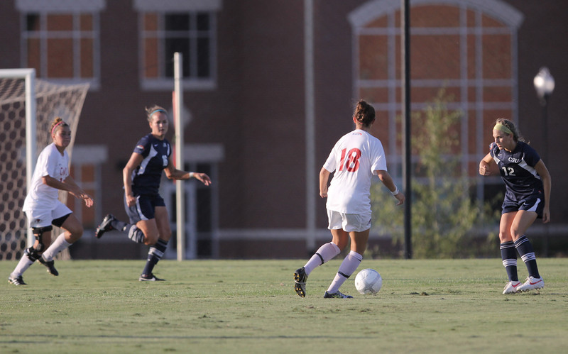 Brooke Kelly (18) puts her eyes on the goal and keeps the ball away from Charleston Southern