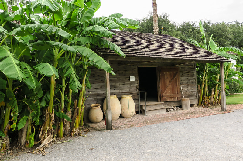 old wooden shack with clay pots in front