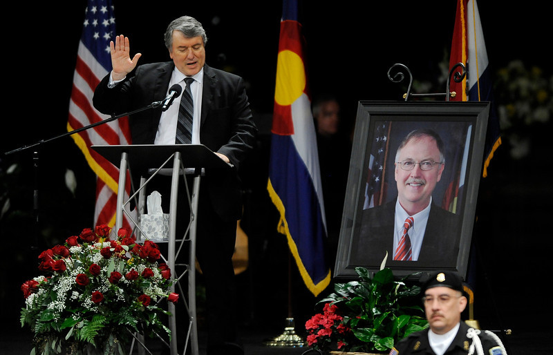 . George Lombardi, left, leads other corrections official in swearing an oath to follow the ideas of Tom Clements during a public memorial for the chief executive of the Colorado Department of Corrections at New Life Church in Colorado Springs, Colo., on Monday, March 25, 2013. Corrections officials and guards from as far away as Morocco are among the hundreds of people who turned out Monday to honor Clements, killed March 19 when he answered the door of his home in a wooded, rural area north of Colorado Springs. (AP Photo/The Gazette, Jerilee Bennett, Pool)