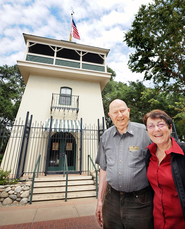 . Eldon Dunn and Carol Hamilton pose for a photo in front of 1900\'s Water Tower at Homestead Museum in City of Industry Thursday, April 4, 2013. The Homestead Museum will honor seven of its volunteers, all local La Puente and Hacienda Heights residents, at its annual Volunteer Appreciation Dinner on Sat., April 6. The volunteers have given more than 4,700 hours of their time to the museum giving tours of the historic homes and properties as well as during the museum\'s festivals, workshops, youth programs and more. The volunteers to be honored are well trained docents with several years of experience. Carol Hamilton (1,000 hrs) and Eldon Dunn (6,000 hrs) of Hacienda Heights. (SGVN/Photo by Walt Mancini/Highlander)