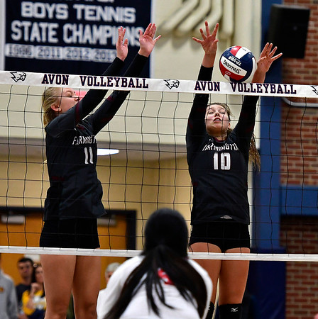 11/1/2018 Mike Orazzi | Staff Farmington High Schools Maya Lipinski (11) and Holly Picchioni (10) during the CCC Volleyball Tournament held at Avon High School Thursday night.