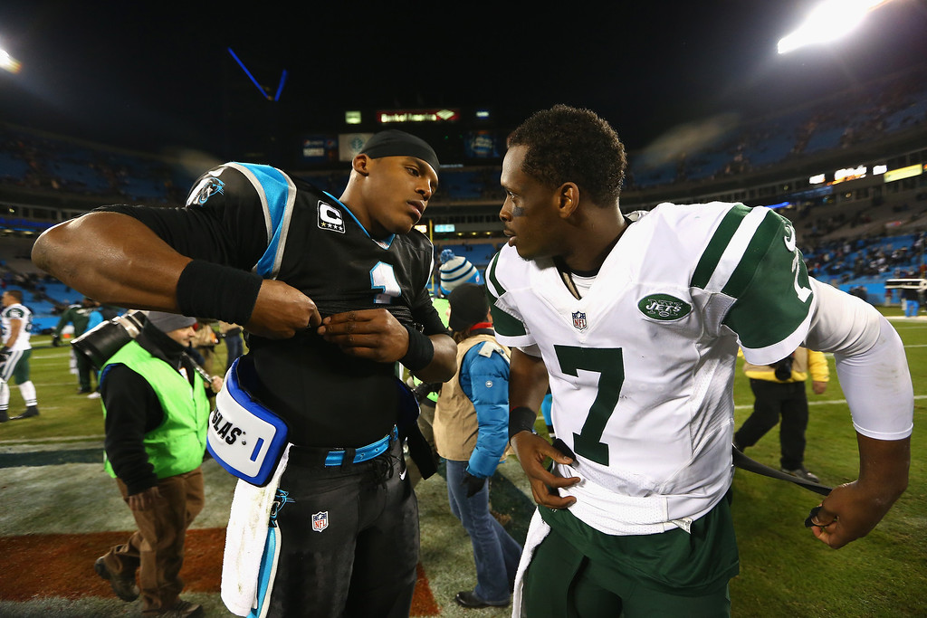 . Cam Newton #1 of the Carolina Panthers and Geno Smith #7 of the New York Jets exchange jerseys after their game at Bank of America Stadium on December 15, 2013 in Charlotte, North Carolina.  (Photo by Streeter Lecka/Getty Images)