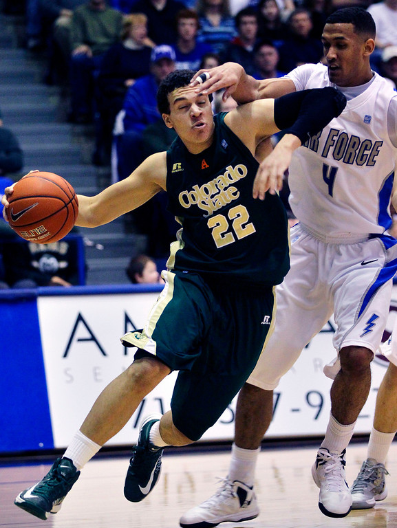 . Colorado State\'s Dorian Green, left, moves the ball downcourt as Air Force\'s Kamryn Williams, right, covers him during the second half of an NCAA college basketball game in Air Force Academy, Colo., Saturday, Feb. 16, 2013. Colorado State won 89-86. (AP Photo/Brennan Linsley)