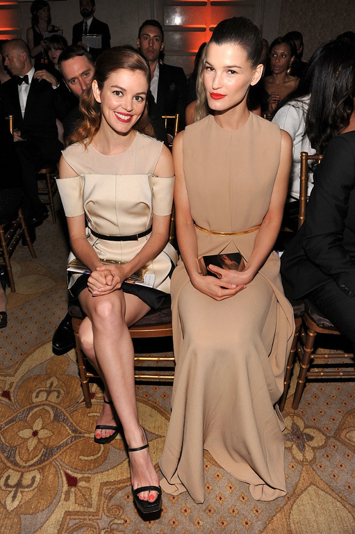 . NEW YORK, NY - JUNE 13:  Actress Nora Zehetner (L) and photographer Hanneli Mustaparta watch the runway show during the 4th Annual amfAR Inspiration Gala New York at The Plaza Hotel on June 13, 2013 in New York City.  (Photo by Jamie McCarthy/Getty Images)