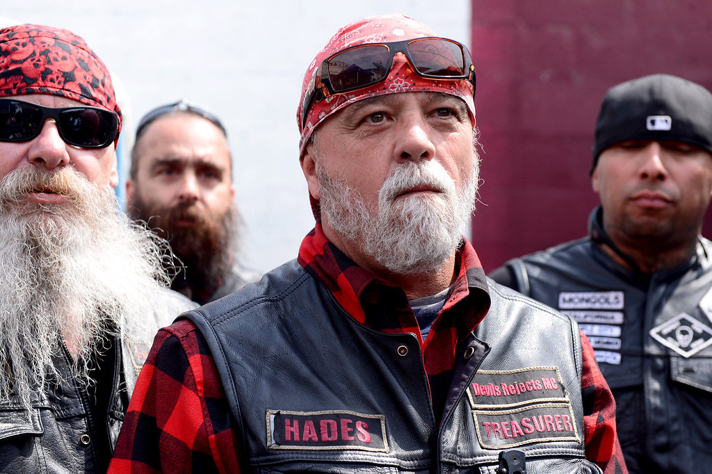 """. Rich \""""Hades\"""" O\'Henley, of Orange County\'s Devils Rejects, center, attends a rally Saturday, March 29, 2013 at The House Lounge in Maywood in support of the Mongols who are facing a federal trial seeking to take away their trademark patch. (Photo by Sarah Reingewirtz/Pasadena Star-News)"""