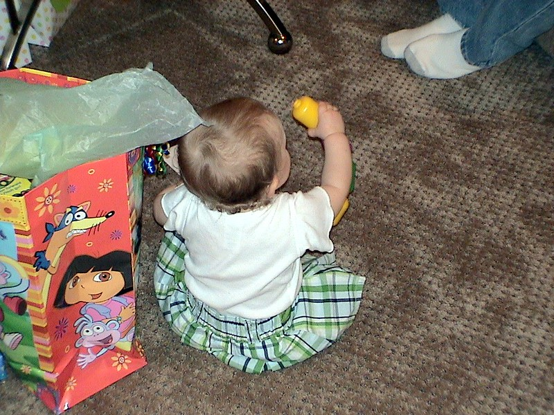 20050129-165221.DSC00556.1stBirthday.PlayingWithGift.jpg