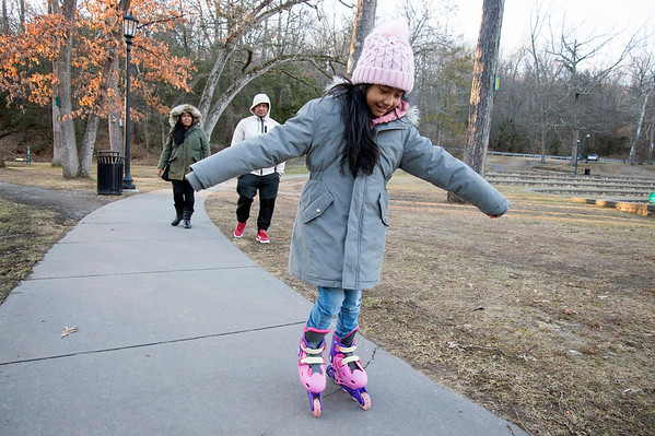 02/03/20 Wesley Bunnell | Staff Amy De Los Santos, age 7, practices her inline skating at Rockwell Park on a mild Monday afternoon as her parents Maria Lopez and Fredy De Los Santos watch.