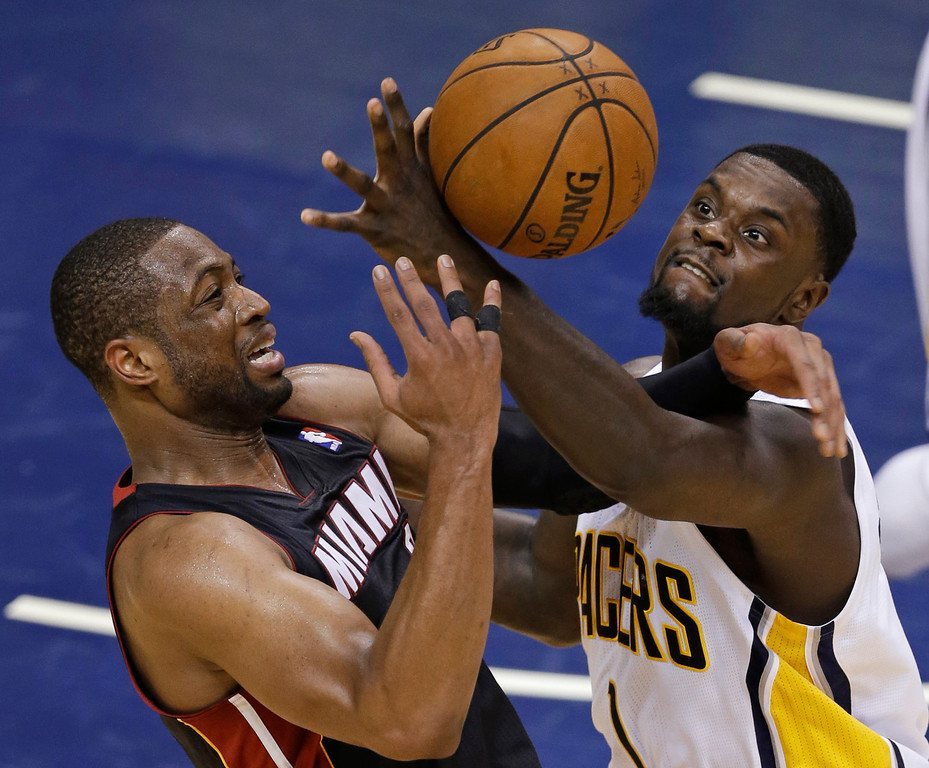 . Miami Heat\'s Dwyane Wade is fouled by Indiana Pacers\' Lance Stephenson during the second half of Game 5 of the Eastern Conference finals NBA basketball playoff series Wednesday, May 28, 2014, in Indianapolis. (AP Photo/Darron Cummings)
