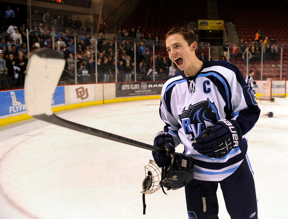 . DENVER, CO. - FEBRUARY 28: Mustangs captain Taner West showed his pride skating off the ice Friday night. Ralston Valley High School beat Monarch 5-1 Friday night, March 1, 2013 to win the Colorado hockey championship at Magness Arena in Denver. (Photo By Karl Gehring/The Denver Post)