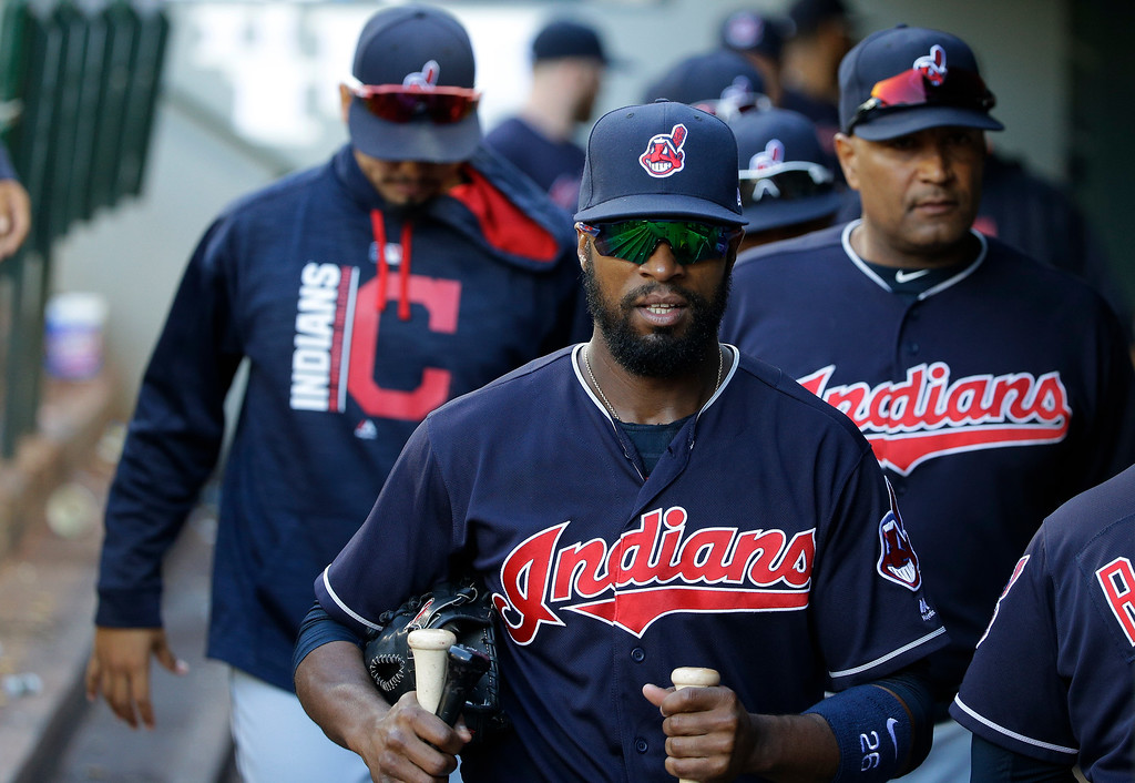 . Cleveland Indians\' Austin Jackson, center, heads to the clubhouse with teammates after the Indians defeated the Seattle Mariners 4-2 during a baseball game, Sunday, Sept. 24, 2017, in Seattle. (AP Photo/Ted S. Warren)