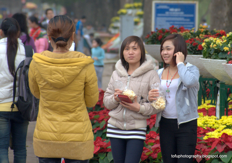 Young women at the Hoàn Kiếm Lake in Hanoi, Vietnam in January 2012