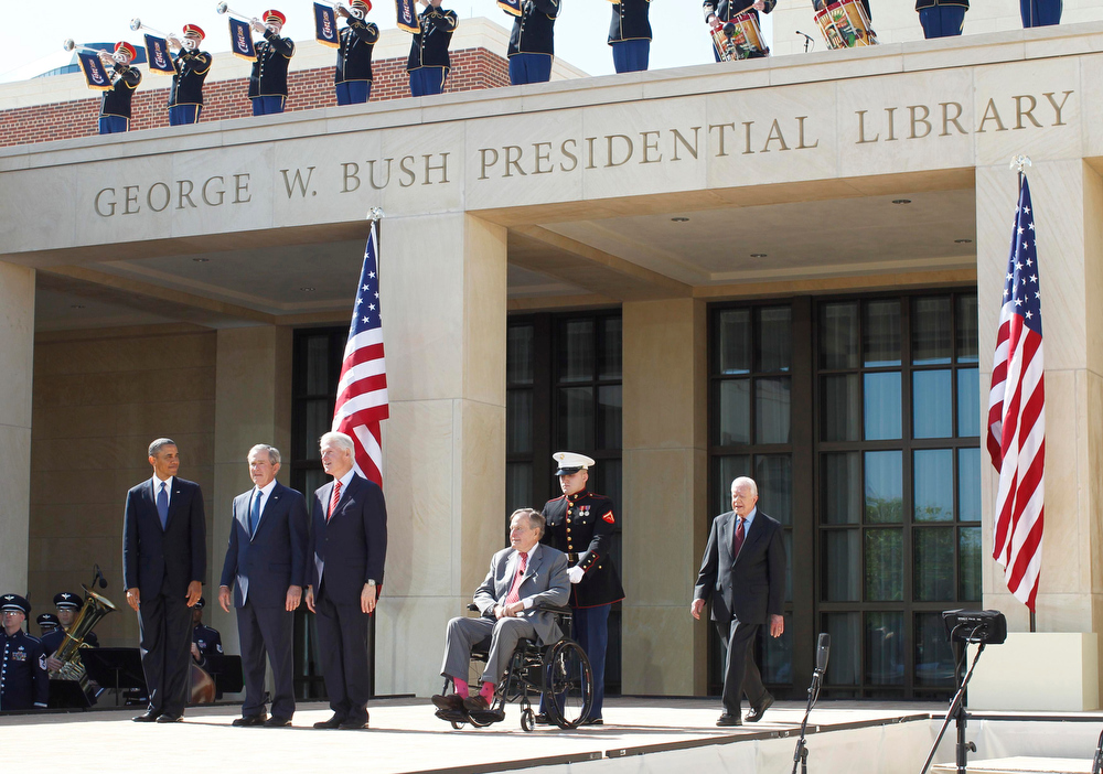 . U.S. President Barack Obama stands alongside former presidents George W. Bush, Bill Clinton, George H.W. Bush and Jimmy Carter as they attend the dedication ceremony for the George W. Bush Presidential Center in Dallas, April 25, 2013. Obama is in Texas to stand shoulder-to-shoulder with former President George W. Bush in what could serve as a powerful reminder of the ongoing struggle against terrorism, from the Sept. 11 attacks to the Boston Marathon bombings. REUTERS/Jason Reed