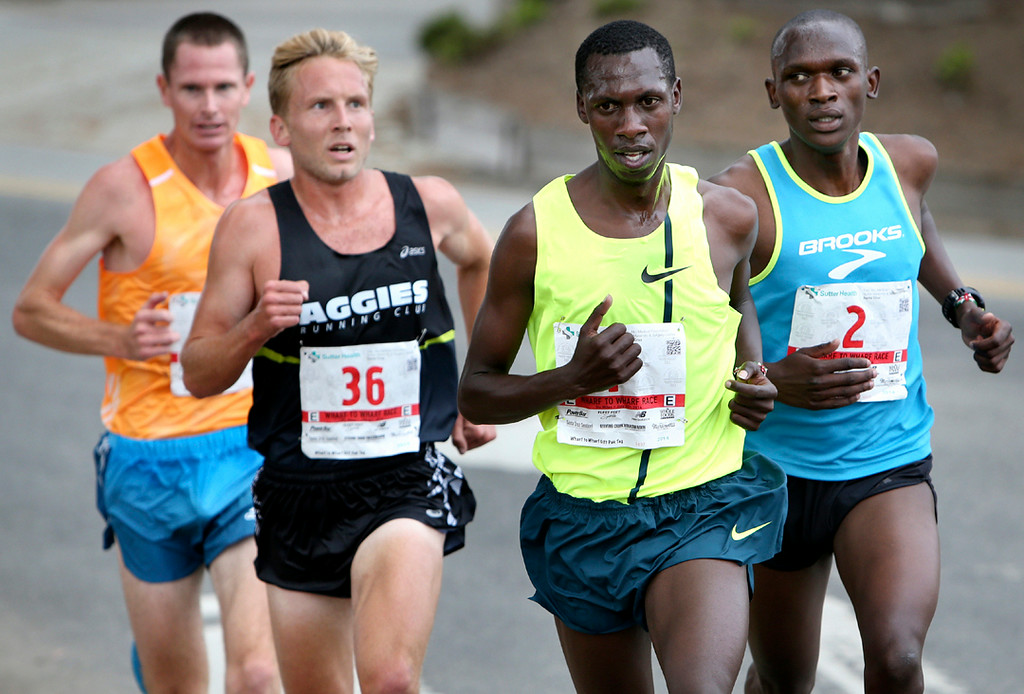 . Wharf to Wharf elite runners Ben Bruce, from left, Scott Bauhs, Simon Ndirangu and last year\'s winner Nelson Oyugi round a corner in Santa Cruz on Sunday during the 42nd annual race. (Kevin Johnson -- Santa Cruz Sentinel)