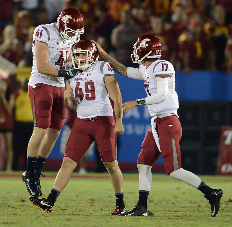 . Washington State\'s Andrew Furney #49 is congratulated after hitting the game winning field goal during their game against USC at the Los Angeles Memorial Coliseum  Saturday, September 7, 2013. Washington State beat USC10-7. (Photo by Hans Gutknecht/Los Angeles Daily News)