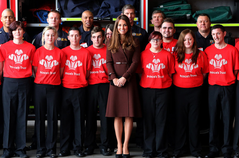. Britain\'s Kate, Duchess of Cambridge, center, poses for a group photograph during her visit to Humberside Fire and Rescue Service, in Grimsby, England, Tuesday, March 5, 2013. The Duchess was visiting The Princeís Trust Team programme, a 12-week personal development scheme which seeks to help unemployed 16-25 year olds build the skills and confidence they need to get a job. (AP Photo/Scott Heppell)
