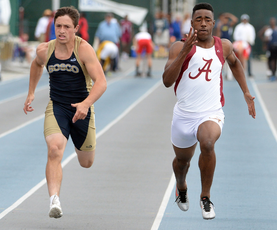 . Alemany\'s Dominic Davis, right, along with Bosco\'s Sean McGew competes in the division 3 100 meter dash during the CIF Southern Section track and final Championships at Cerritos College in Norwalk, Calif., Saturday, May 24, 2014.   (Keith Birmingham/Pasadena Star-News)