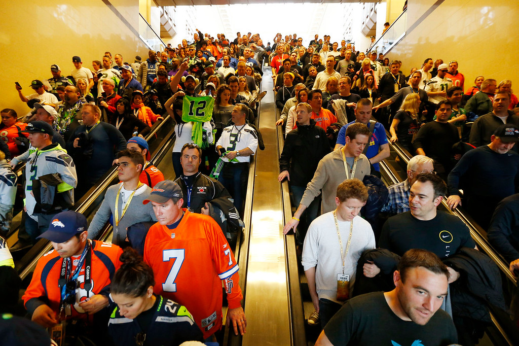 . Football fans make their way to trains on Sunday, Feb. 2, 2014, in Secaucus, N.J. The Seattle Seahawks are scheduled to play the Denver Broncos in NFL football\'s Super Bowl XLVIII game on Sunday evening at MetLife Stadium in East Rutherford, N.J. (AP Photo/Matt Rourke)