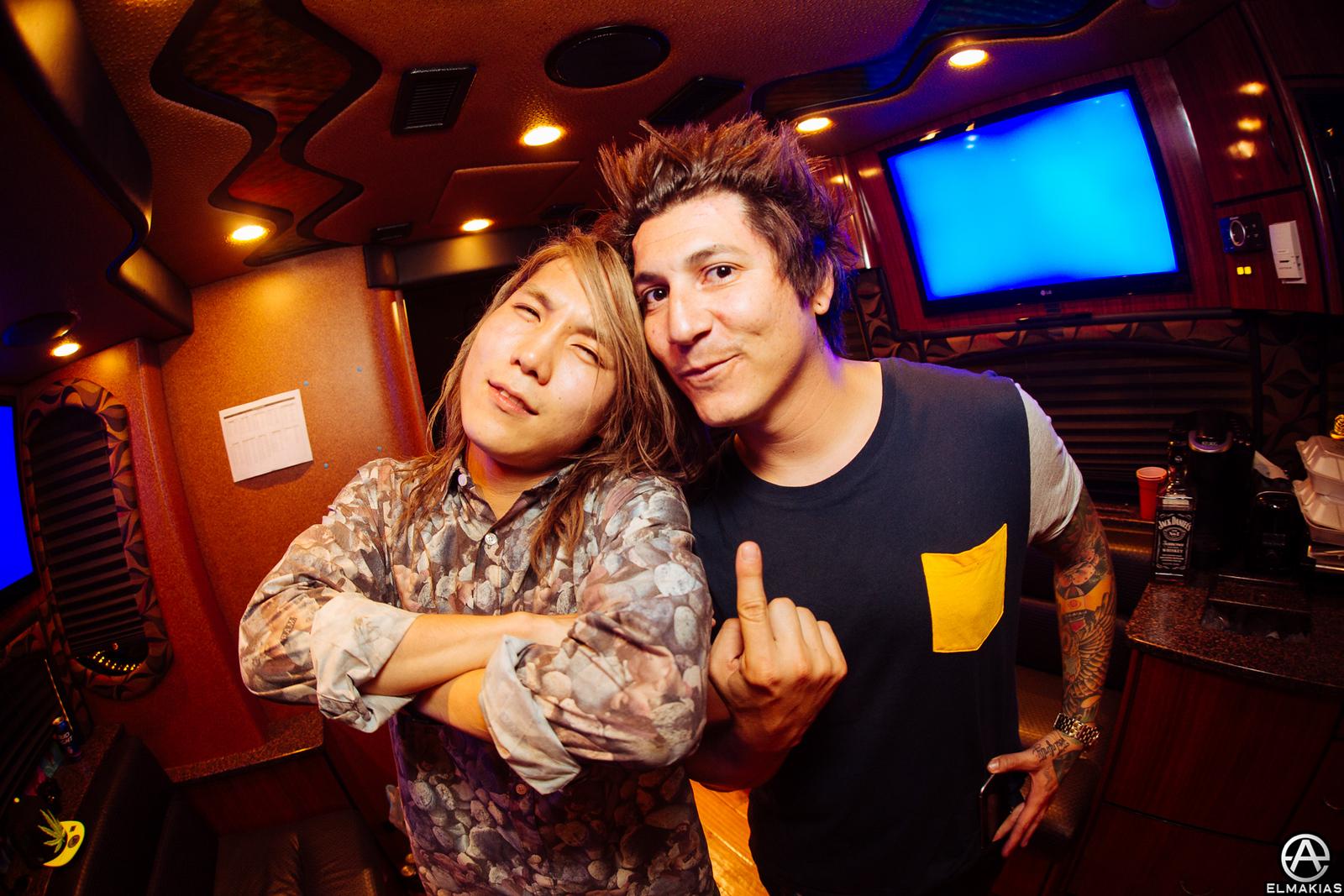 Hiroki Ikegawa of Crossfaith and Jaime Preciado of Pierce The Veil at Vans Warped Tour 2015 by Adam Elmakias
