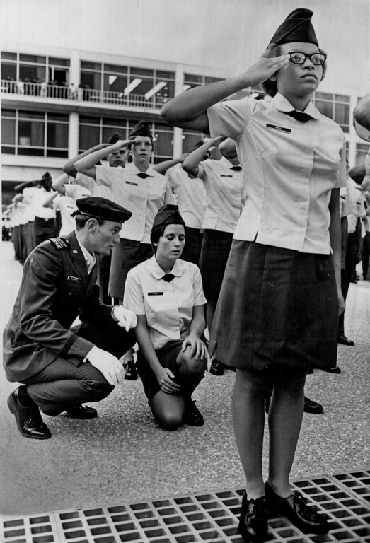 . Susan Park, Bossier Louisiana, Kneels down after getting dizzy during swearing in ceremonies. 1976. The Denver Post Library Archive