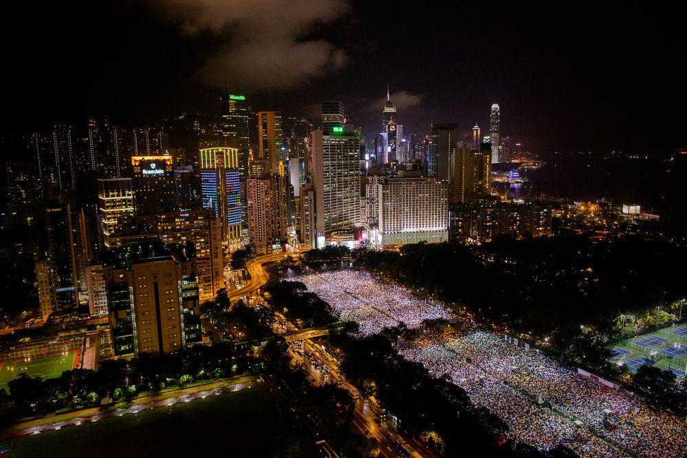 . People are seen gathered at Victoria Park during a candlelight vigil held to mark the 24th anniversary of the 1989 crackdown at Tiananmen Square, in Hong Kong on June 4, 2013.  More than 100,000 people were expected to attend the candlelight vigil in the former British colony which is the only place in China where the brutal military intervention that ended weeks of nationwide democracy protests in 1989 is openly commemorated.  PHILIPPE LOPEZ/AFP/Getty Images