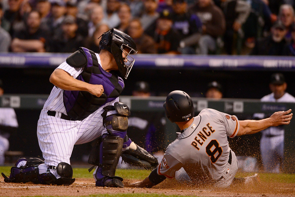 . DENVER, CO - APRIL 12: Colorado Rockies catcher Nick Hundley (4) tags San Francisco Giants right fielder Hunter Pence (8) as he tries to slide into home during the third inning at Coors Field on April 12, 2016 in Denver, Colorado. (Photo by Brent Lewis/The Denver Post)