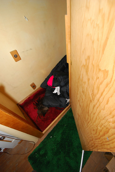 This is a little closet in the cold room. Was the carefully placed wig and sleeping bag a little joke from the seller?