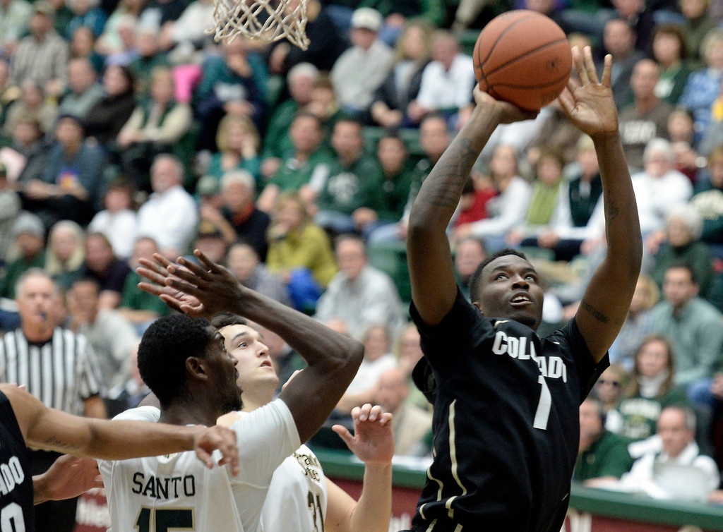 . CU\'s  Wesley Gordon takes a shot over Gerson Santo during an NCAA game against CSU on Tuesday, Dec. 3, 2013, at the Moby Arena in Fort Collins. Jeremy Papasso/ Camera