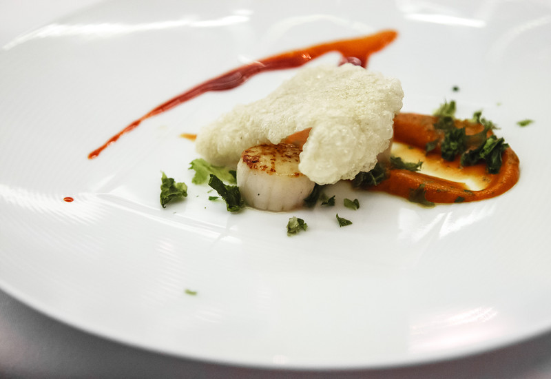 Scallop, oyster cracker, sea lettuce, tomato