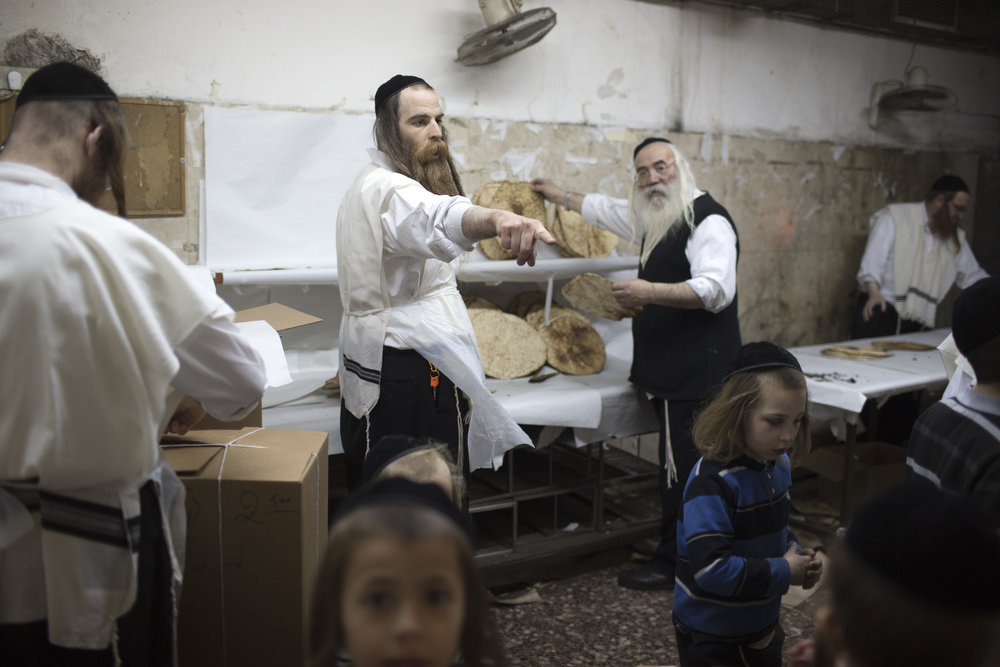 . An Ultra-Orthodox Jewish man selects the Matzoth, or unleavened bread, after it was baked on March 19, 2013, in Jerusalem. Religious Jews throughout the world eat matzoth during the eight-day Pesach holiday (Passover), which begins on March 25, with the sunset to commemorate the Israelis\' exodus from Egypt some 3,500 years ago and commemorate their ancestors\' plight by refraining from eating leavened food products. MENAHEM KAHANA/AFP/Getty Images