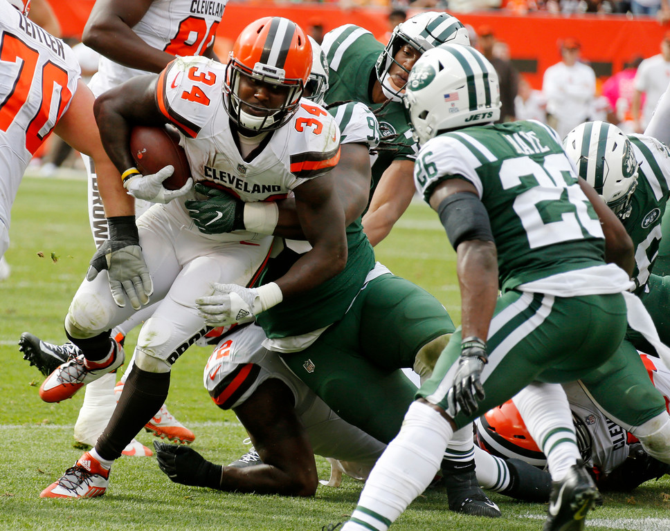 . Cleveland Browns running back Isaiah Crowell (34) runs the ball against the New York Jets during the second half of an NFL football game, Sunday, Oct. 8, 2017, in Cleveland. (AP Photo/Ron Schwane)