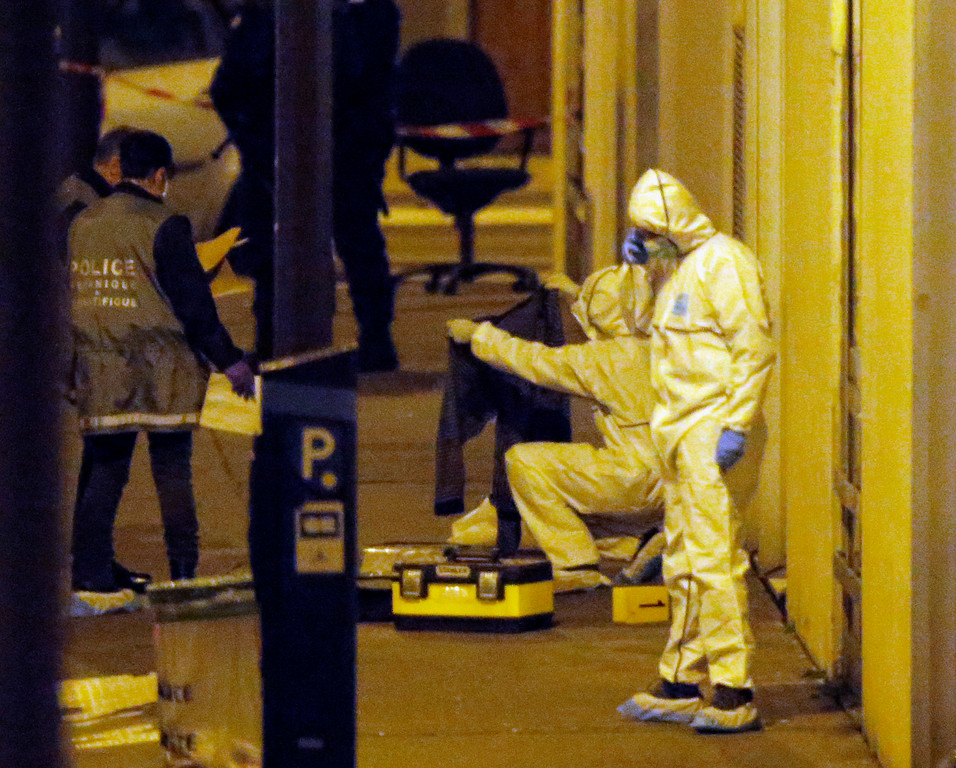 ". French forensic experts and Police officers examine evidence outside the French satirical newspaper Charlie Hebdo\'s office, in Paris, Wednesday, Jan. 7, 2015. Masked gunmen shouting ""Allahu akbar!\"" stormed the Paris offices of the satirical newspaper Charlie Hebdo, killing at least 12 people, including the paper\'s editor and a cartoonist, before escaping in a getaway car. It was France\'s deadliest terror attack in at least two decades. (AP Photo/Francois Mori)"