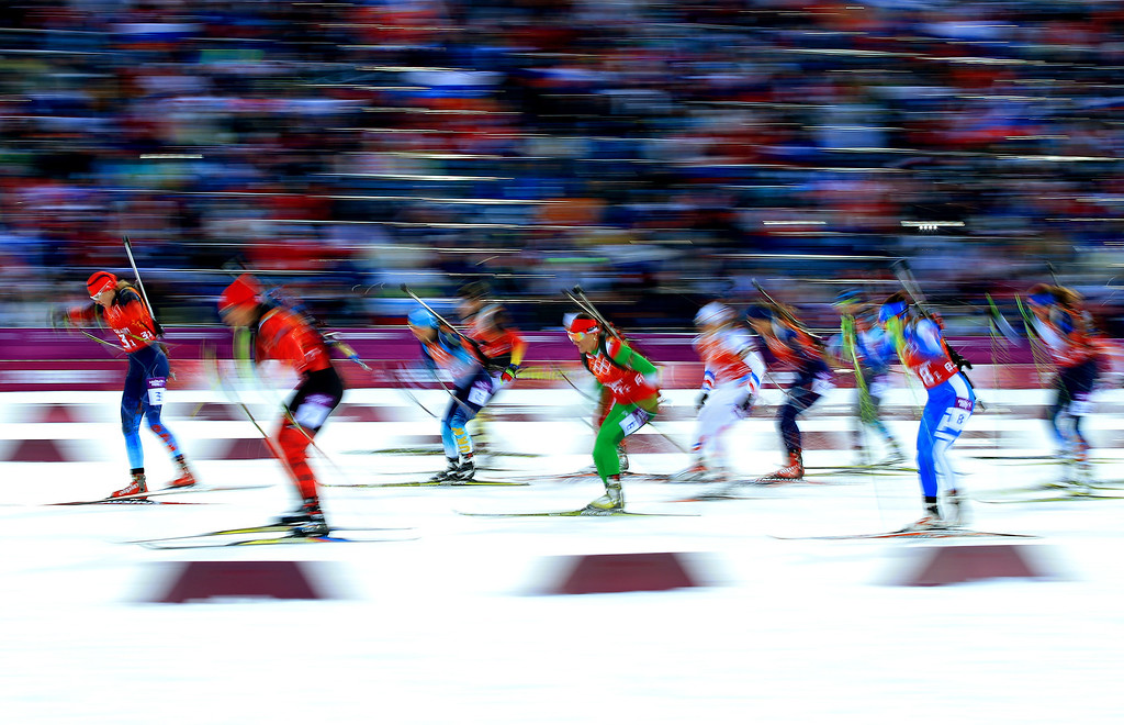 . SOCHI, RUSSIA - FEBRUARY 21:  Athletes start the Women\'s 4 x 6 km Relay during day 14 of the Sochi 2014 Winter Olympics at Laura Cross-country Ski & Biathlon Center on February 21, 2014 in Sochi, Russia.  (Photo by Richard Heathcote/Getty Images)