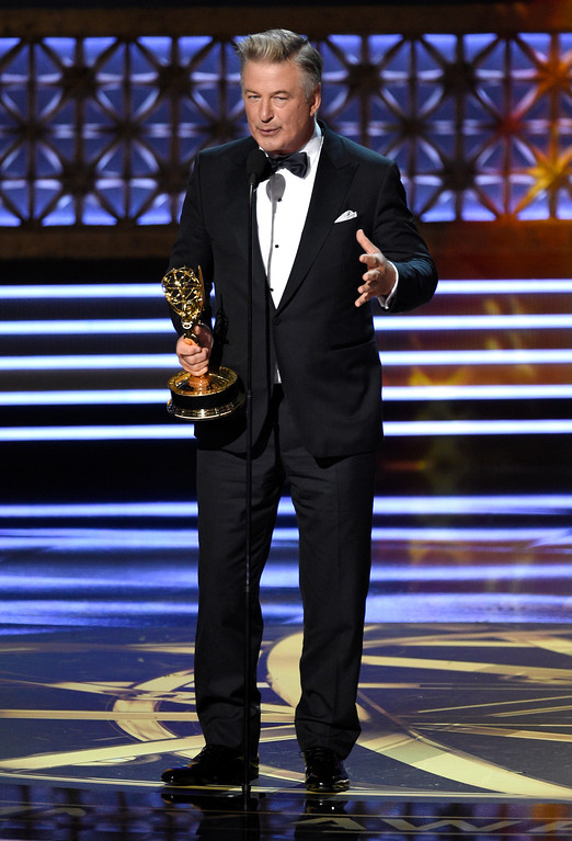 ". Alec Baldwin accepts the award for outstanding supporting actor in a comedy series for ""Saturday Night Live\"" at the 69th Primetime Emmy Awards on Sunday, Sept. 17, 2017, at the Microsoft Theater in Los Angeles. (Photo by Chris Pizzello/Invision/AP)"
