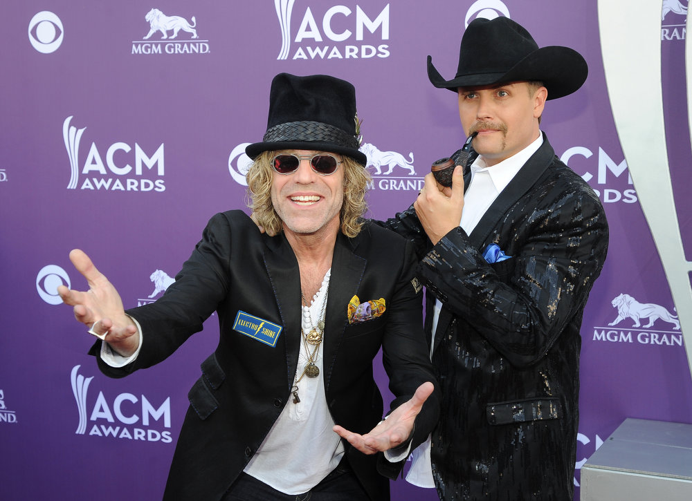 . Big Kenny, left, and John Rich, of musical duo Big & Rich, arrive at the 48th Annual Academy of Country Music Awards at the MGM Grand Garden Arena in Las Vegas on Sunday, April 7, 2013. (Photo by Al Powers/Invision/AP)
