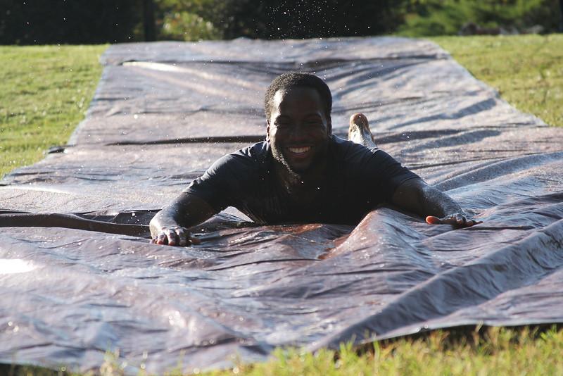 Cameron Freeman takes a stroll down the slip-n-slide.