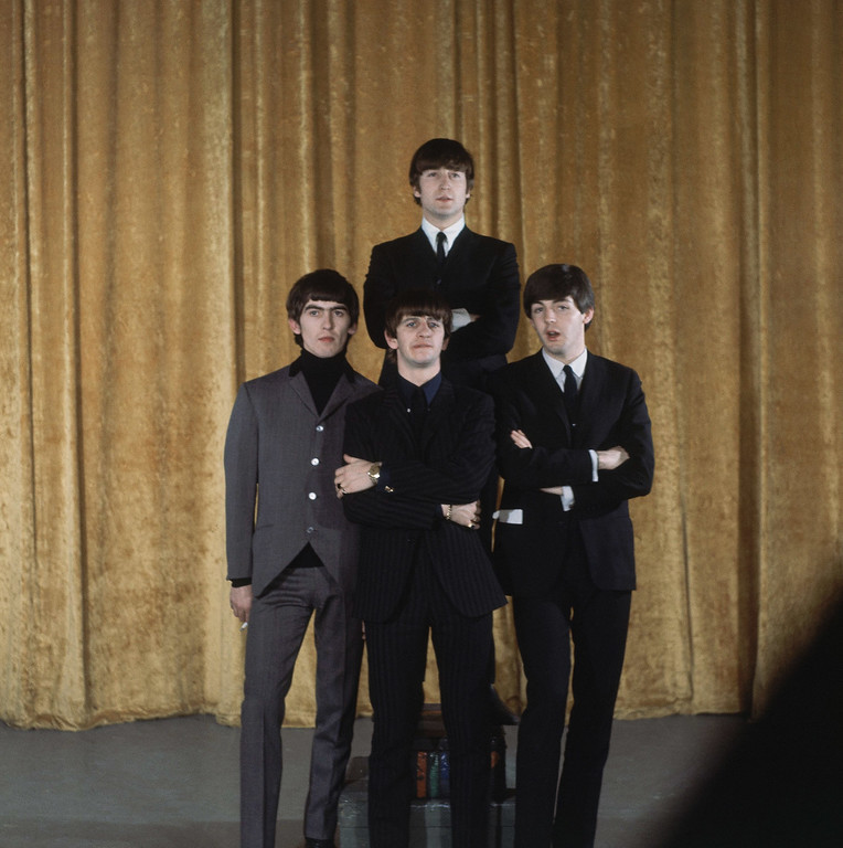 ". The Beatles are shown on the set of the ""Ed Sullivan Show\"" in New York, Feb. 10, 1964.  In back is John Lennon; the others, from left to right, are: George Harrison, Ringo Starr and Paul McCartney. (AP Photo)"
