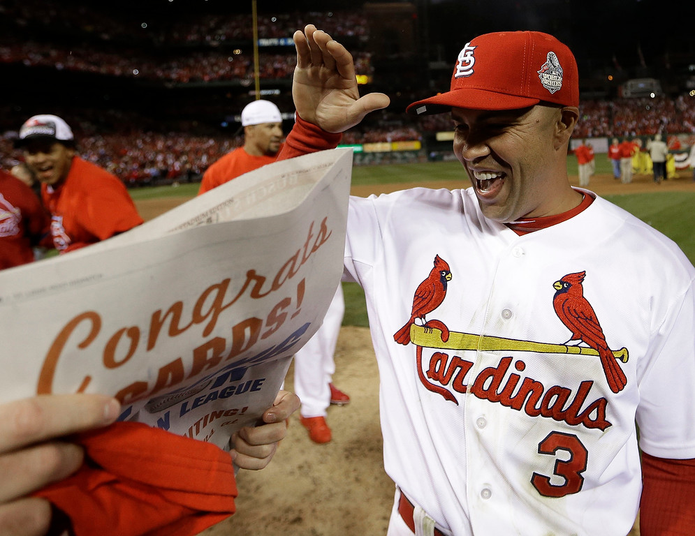 . St. Louis Cardinals\' Carlos Beltran celebrates after Game 6 of the National League baseball championship series against the Los Angeles Dodgers, Friday, Oct. 18, 2013, in St. Louis. The Cardinals won 9-0 to win the series. (AP Photo/David J. Phillip)