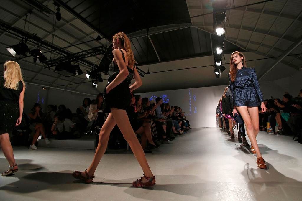 . Models present creations as part of French fashion designer Julien David\'s ready-to-wear Spring/Summer 2014 fashion collection presented in Paris, Tuesday, Sept. 24, 2013. (AP Photo/Christophe Ena)