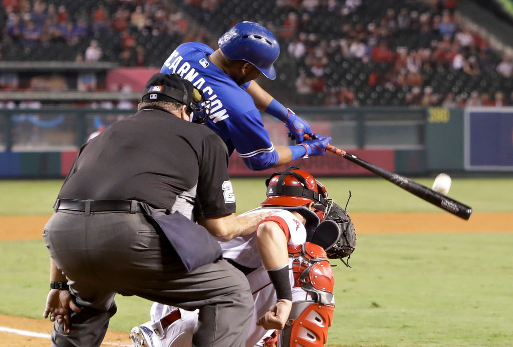 . Toronto Blue Jays\' Edwin Encarnacion hits a two-run home run against the Los Angeles Angels during the ninth inning of a baseball game in Anaheim, Calif., Friday, Sept. 16, 2016. (AP Photo/Chris Carlson)