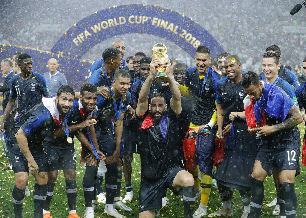 . France\'s Adil Rami celebrates with the trophy after the final match between France and Croatia at the 2018 soccer World Cup in the Luzhniki Stadium in Moscow, Russia, Sunday, July 15, 2018. France won the final 4-2. (AP Photo/Matthias Schrader)