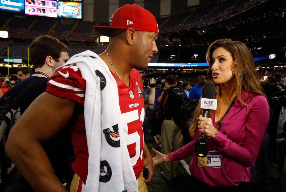 Description of . Clark Haggans #51 of the San Francisco 49ers is interviewed by Katherine Webb of 'Inside Edition' during Super Bowl XLVII Media Day ahead of Super Bowl XLVII at the Mercedes-Benz Superdome on January 29, 2013 in New Orleans, Louisiana. The San Francisco 49ers will take on the Baltimore Ravens on February 3, 2013 at the Mercedes-Benz Superdome.  (Photo by Scott Halleran/Getty Images)
