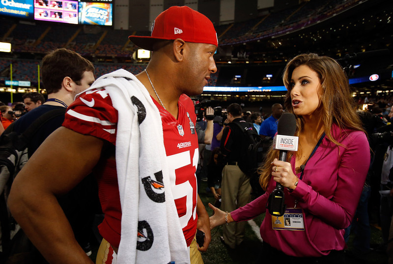 . Clark Haggans #51 of the San Francisco 49ers is interviewed by Katherine Webb of \'Inside Edition\' during Super Bowl XLVII Media Day ahead of Super Bowl XLVII at the Mercedes-Benz Superdome on January 29, 2013 in New Orleans, Louisiana. The San Francisco 49ers will take on the Baltimore Ravens on February 3, 2013 at the Mercedes-Benz Superdome.  (Photo by Scott Halleran/Getty Images)