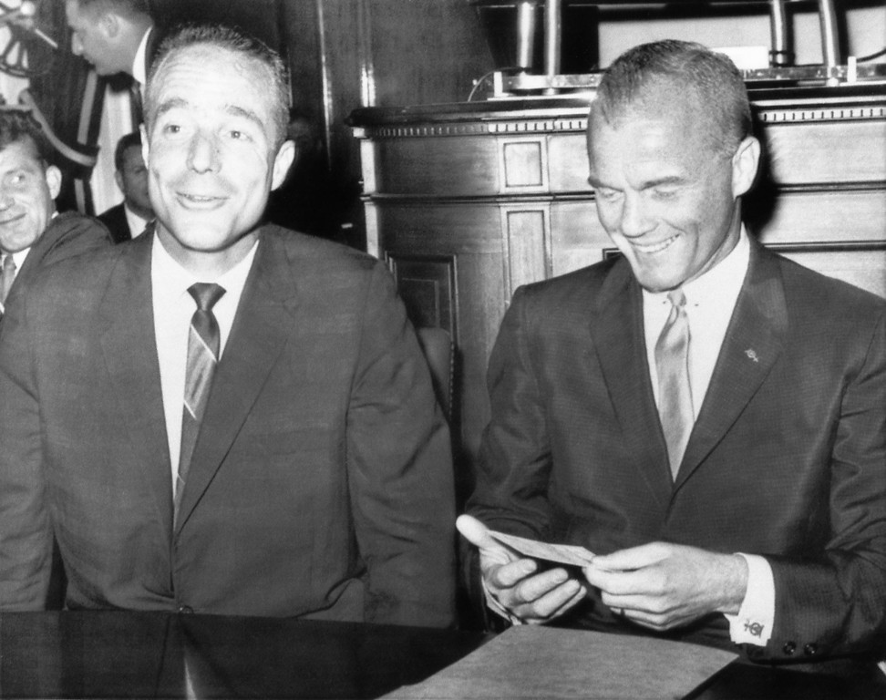 . Astronauts Scott Carpenter, left, and John Glenn sit at the witness table of a House Space Subcommittee on July 18, 1962, in Washington. They were called for testimony at a hearing on the qualifications for astronauts. (AP Photo)