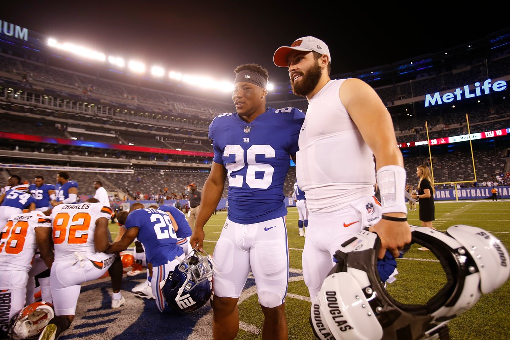. New York Giants running back Saquon Barkley, left, poses for photographs with Cleveland Browns quarterback Baker Mayfield after a preseason NFL football game Thursday, Aug. 9, 2018, in East Rutherford, N.J. The Browns won 20-10. (AP Photo/Adam Hunger)
