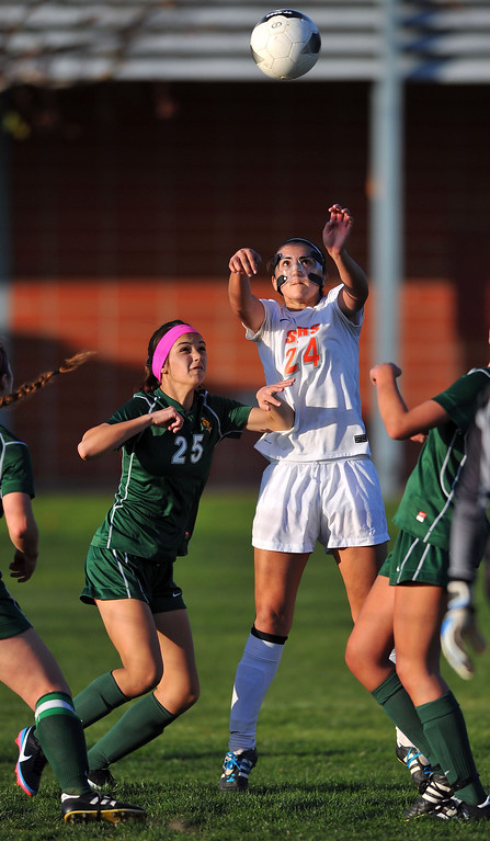 . LAKEWOOD - 02/14/2013  (Photo: Scott Varley, Los Angeles Newspaper Group)  St. Joseph hosts La Reina (Thousand Oaks) in a first-round Division 3 girls soccer playoff game. St. Joseph won 4-0. St. Joseph\'s Natalie De Leon, right, sets herself for a header on a throw-in as Sophia Lima defends.