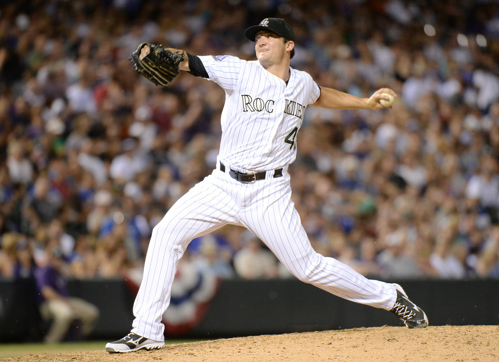 . DENVER, CO. - July 03: Rex Brothers of Colorado Rockies (49) pitch against Los Angeles Dodgers in the 9th inning of the game at Coors Field. Denver, Colorado. July 3, 2013. Los Angeles won 10-8. (Photo By Hyoung Chang/The Denver Post)