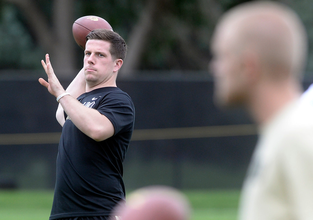 . University of Colorado quarterback Jordan Webb gets some throws in  during the second fall football practice on Wednesday, Aug. 7, at the CU practice fields. Webb is not dressed for practice due to legal problems. For more photos of practice go to www.dailycamera.com Jeremy Papasso/Camera