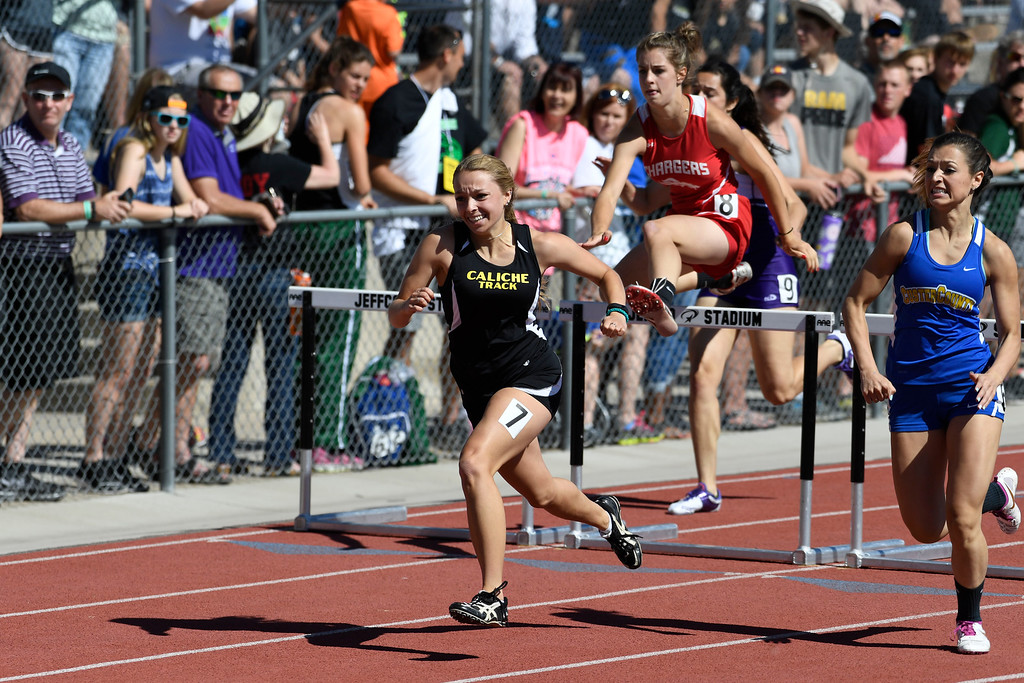 . Jaedyn Lambrecht, Caliche, heads to the finish line to win the girls 2A 100 meter hurdles final edging out Serenity Ham, right, Custer County at the Colorado Track and Field State Championships at Jeffco Stadium May 21, 2016. (Photo by Andy Cross/The Denver Post)