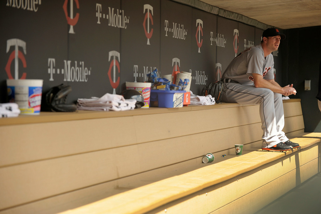. Detroit Tigers� Max Scherzer sits in the Tigers\' dugout prior to warming up to pitch against the Minnesota Twins\' in a baseball game in Minneapolis, Sunday, Aug. 24, 2014. (AP Photo/Tom Olmscheid)